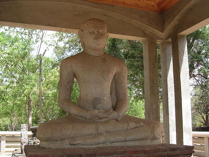This is a current-day photo of the Samadhi Statue, located in Anuradhapura.