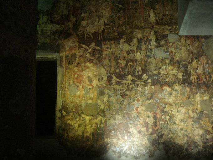 This photo shows an example of a fresco painting. The fragments of murals and paintings in the caves depict the past lives and rebirths of the Buddha.