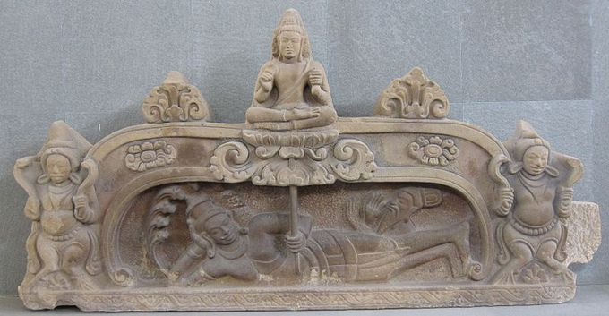 This photo shows a sculpture of the birth of Brahma. This unfinished pediment is a fine example of Hindu art in the style of Champa. The relief sculpture shows the birth of the Hindu god Brahma from a lotus growing from the navel of Vishnu.