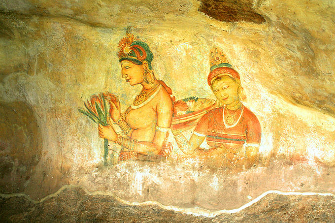 This is a photo of a Sigiriya fresco. The frescoes at Sigiriya depict graceful female figures bearing flowers, such as this one.
