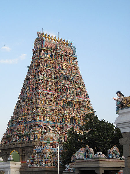 This photo shows the tower (gopuram) of the Kapaleeswarar Temple, a typical South Indian temple complex in Chennai, Tamil Nadu.