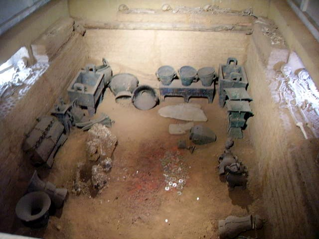 Photo of the tomb showing a variety of artifacts.