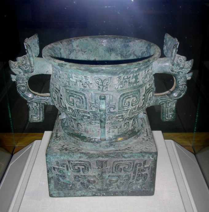 An elaborately decorated vessel with two handles.
