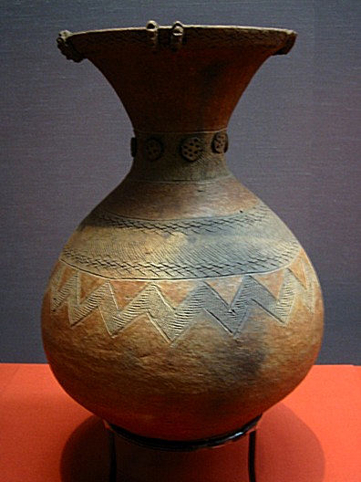 A jar with simple geometric patterns.