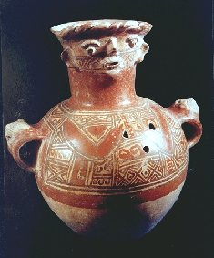 This urn is decorated with geometric shapes and a face at the top.