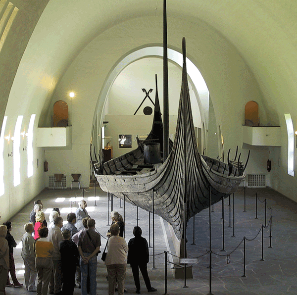 Image of a group of people viewing the ship in a museum.