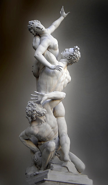 Sculpture consists of three figures: a man lifting a woman into the air while a second man crouches.
