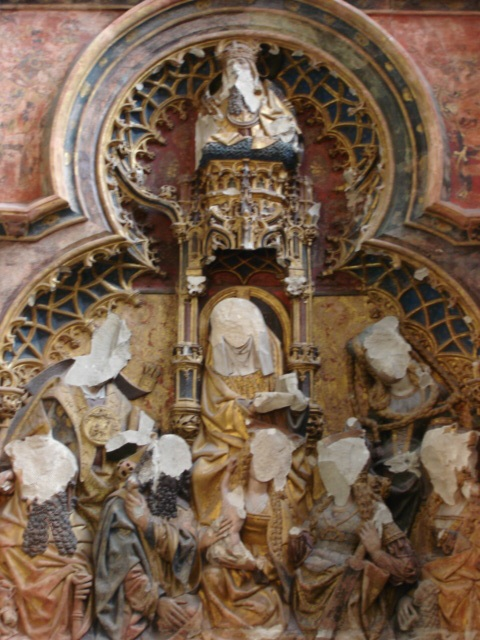 An alter piece with the figures defaced.