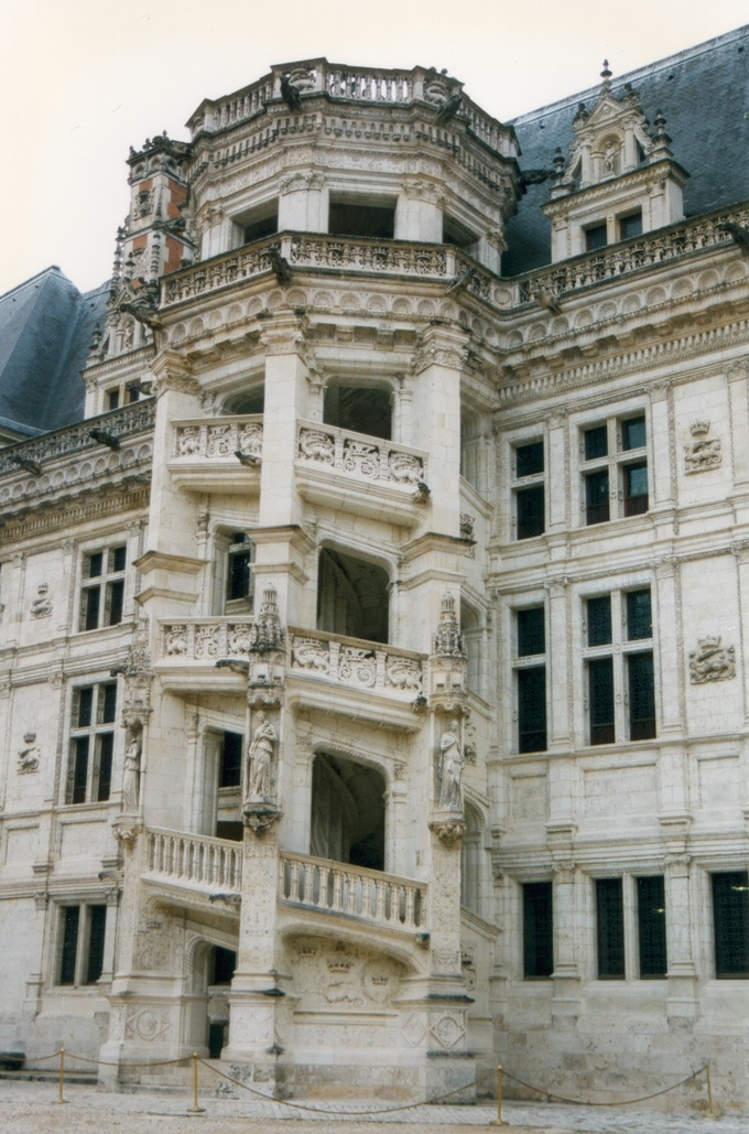 The spiral staircase is covered with fine bas-relief sculptures and looking out onto the château's central court.