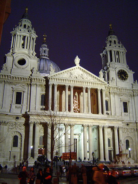 Picture of the west front of the cathedral. It shows a boldly projecting Classical portico with paired columns and two towers on either side.