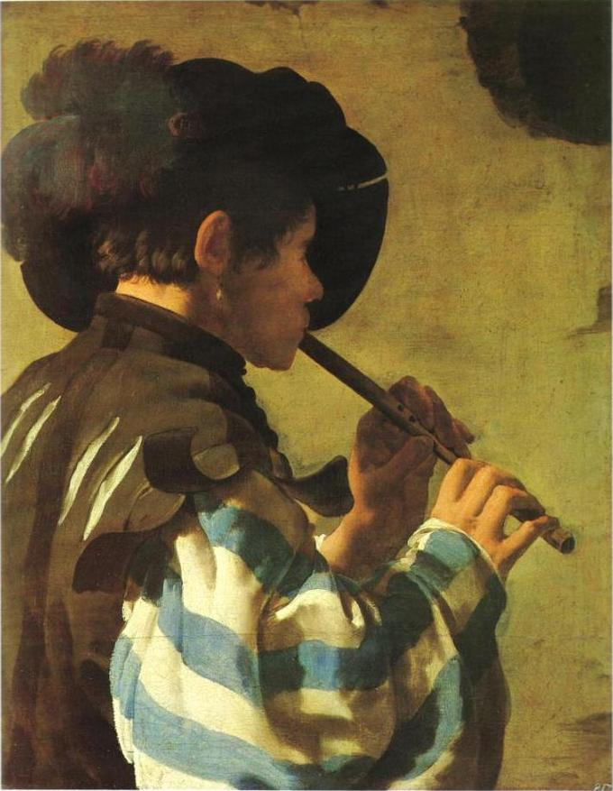 A man is shown playing a flute. He is seen from the side, looking away from the viewer.