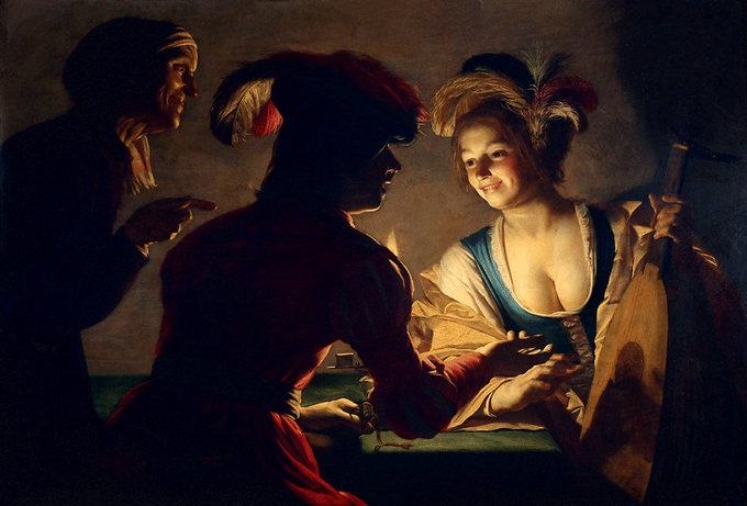Scene depicts a woman lit by a single candle, leaning on a table, smiling. Two men in shadows are conversing with her.