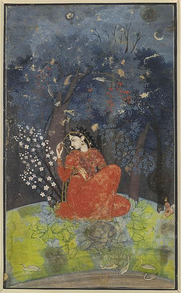 A woman in red is sitting on the ground beneath some trees.