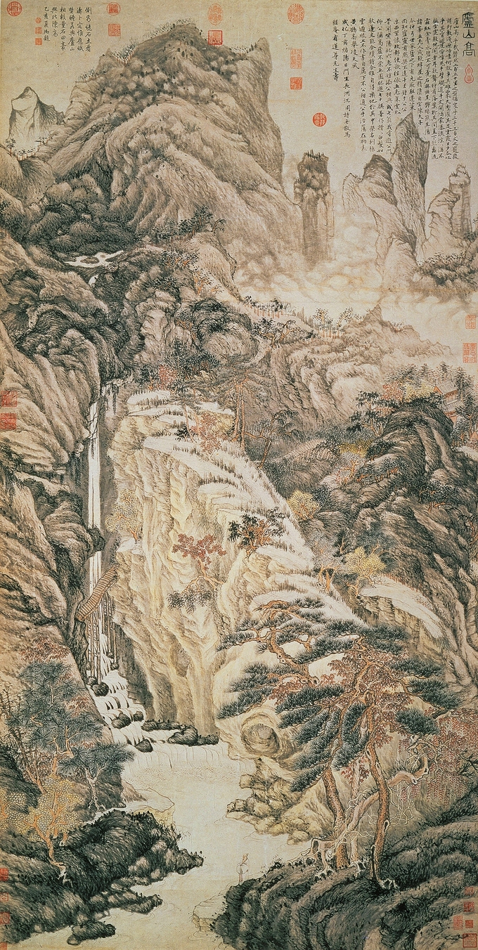 Landscape with a tall waterfall in the foreground and a mountain in the background.