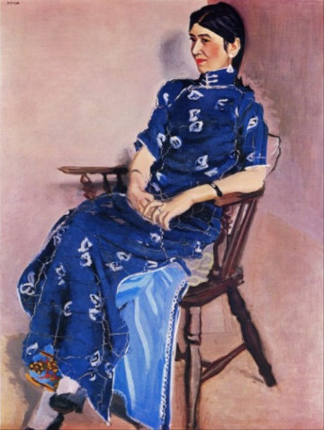 Chin-Jung is depicted leaning back in a chair, looking relaxed, wearing a bright blue dress.