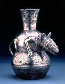 Bronze bottle with an animal carved in its middle.