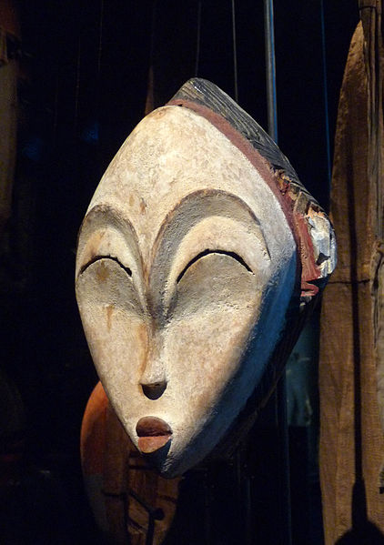 this mask is in the form of a human face and has very little decoration