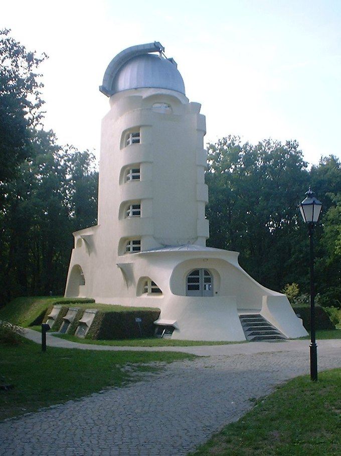 Image of the tower from outside. It is a white tower with an observatory at the top.