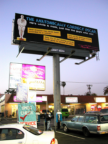 "A photo of a billboard describing the ""anatomically correct Oscar"" and pointing out facts about inequality at the Oscars."