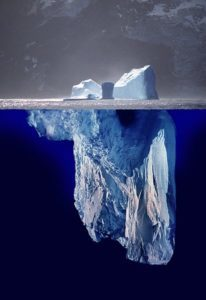 Image of iceberg, with most of the iceberg below the surface of the water.