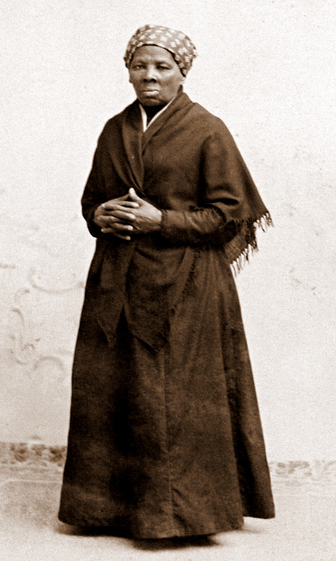 Photograph of Harriet Tubman standing with her hands crossed