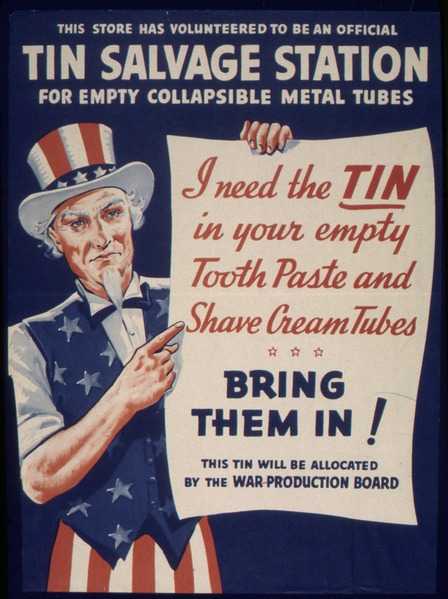 "The text at the top of the poster reads, ""This store has volunteered to be an official tin salvage station for empty collapsible metal tubes."" Below Uncle Sam holds up a poster that reads, ""I need the tin in your empty tooth paste and shave cream tubes. Bring them in! This tin will be allocated by the War Production Board."""