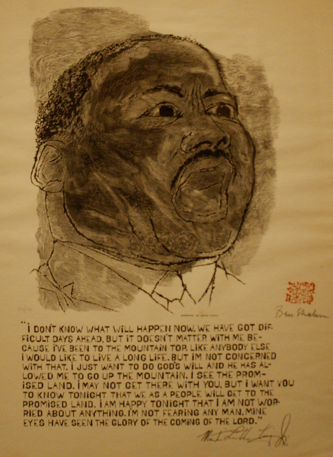 "A quotation by MLK, Jr. appears below the portrait. It reads: ""I don't know what will happen now. We have got difficult days ahead, but it doesn't matter with me because I've been to the mountain top. Like anybody else I would like to live a long life. But I'm concerned with that. I just want to do God's will and he has allowed me to go up to the mountain. I see the Promised Land. I may not get there with you, but I want you to know tonight that we as a people will get to the Promised Land. I am happy tonight that I am not worried about anything. I'm not fearing any man. Mine eyes have seen the glory of the coming of the Lord."""