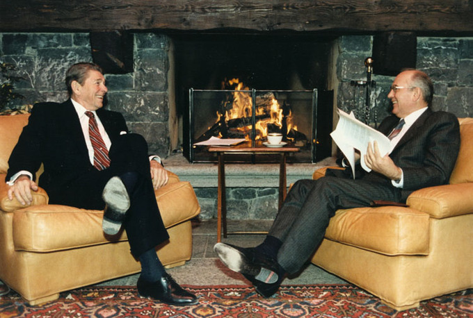 U.S. President Ronald Reagan and Soviet General Secretary Mikhail Gorbachov talking in front of a fireplace at the first Summit in Geneva, Switzerland.