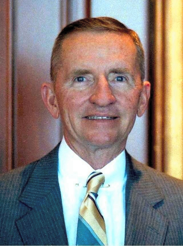 A color portrait of Ross Perot