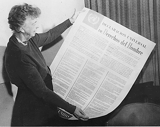 Image of Eleanor Roosevelt holding the United Nations Universal Declaration of Human Rights in Spanish