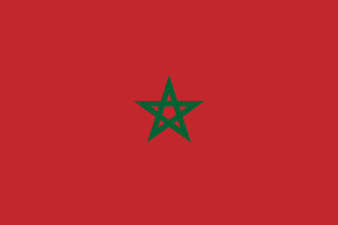 Image of the Moroccan flag, which is red with a green star in the center.