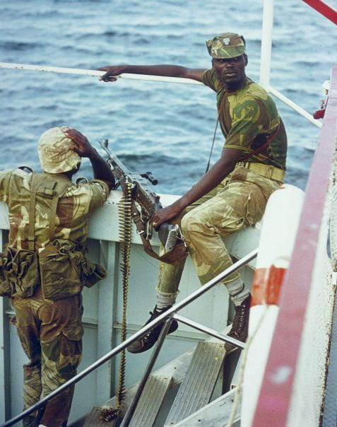 Photo of black soldiers aboard a military boat during the Bush War.