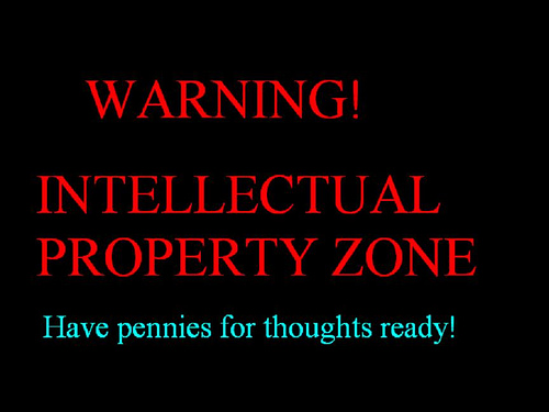 A message is written in red and blue on a black background. It says: WARNING! INTELLECTUAL PROPERTY ZONE. Have pennies for thoughts ready!