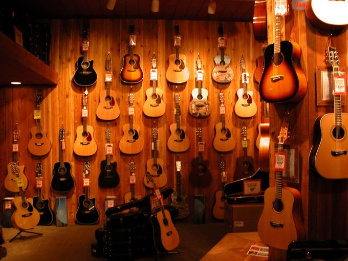 guitars on the wall of a store