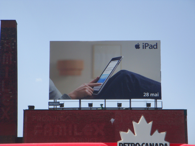 A billboard advertisement for Apple's iPad