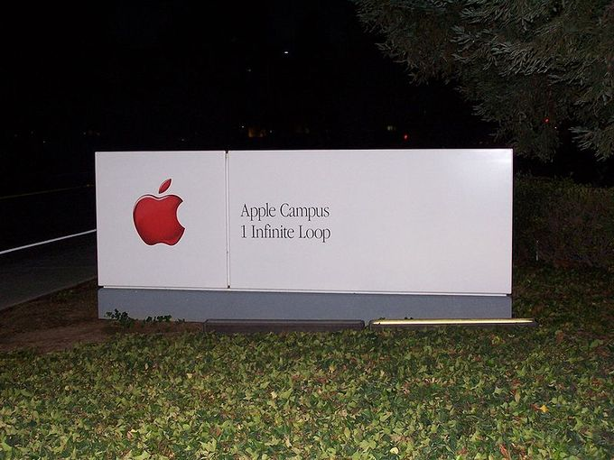 "An Image of the sign for the Apple Campus reading ""1 Infinite Loop"""