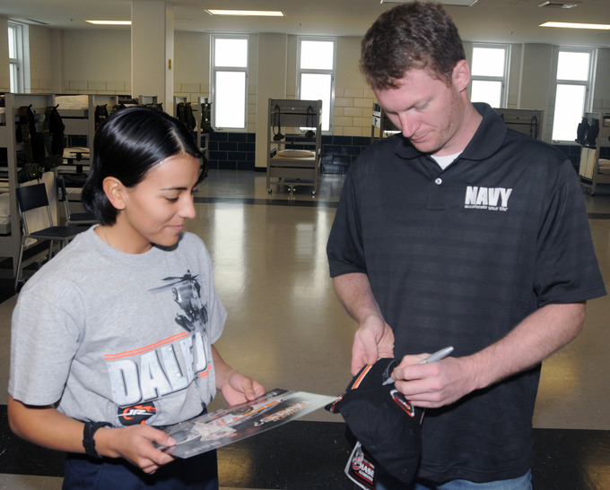 Dale Earnheart Jr. signing a woman's personal belongings