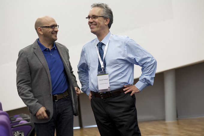 Two men talking at a business conference.