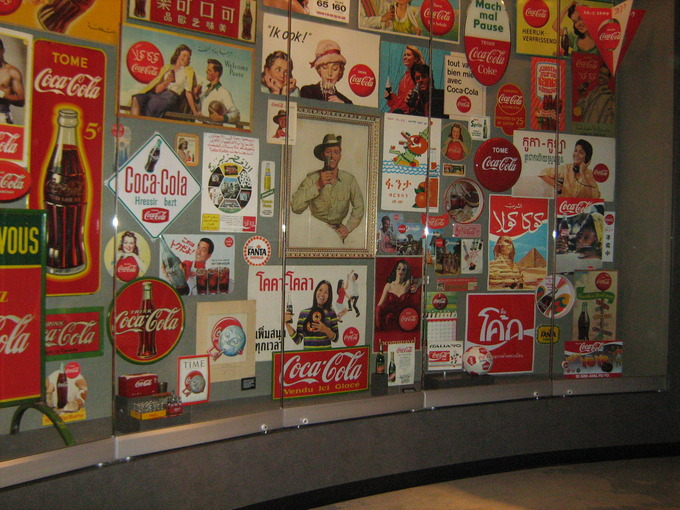 A display case that shows Coke signs from around the globe.