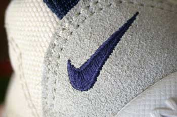 A Nike swoosh on a shoe.