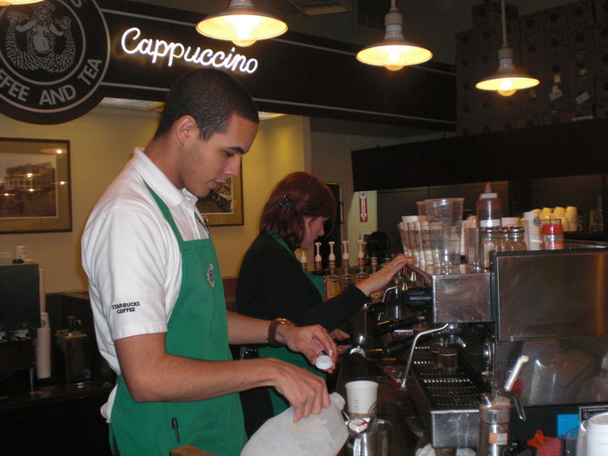Baristas working in the first Starbucks coffee shop in Seattle, Washington.
