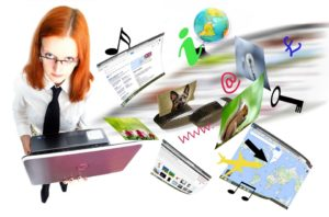 A woman holding a laptop with web pages and other symbols floating out of the laptop