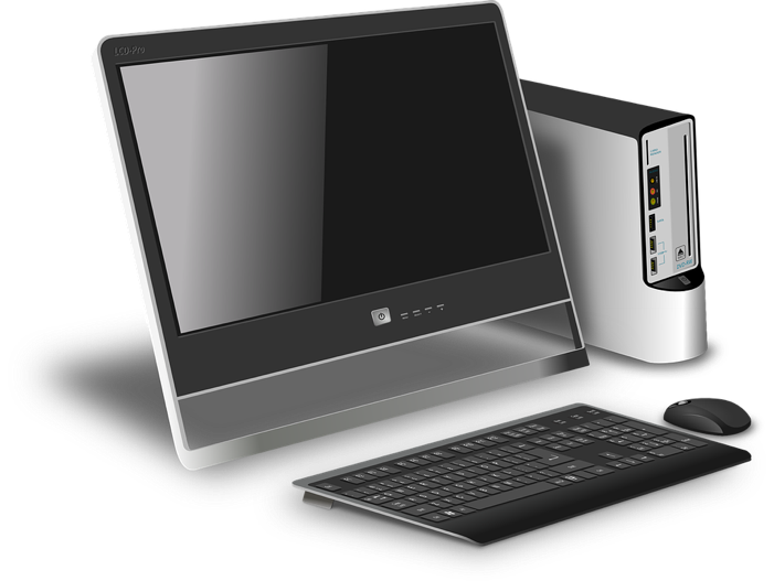 A computer monitor, tower, keyboard, and mouse