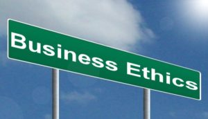 """Green sign with the words """"Business Ethics"""" on it"""