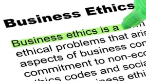 Portion of the definition of business ethics with someone beginning to highlight text in green
