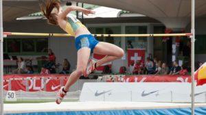 Female high jumper in mid jump
