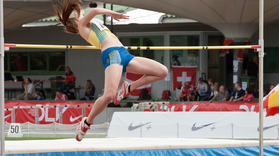 Female high jumper in mid jump