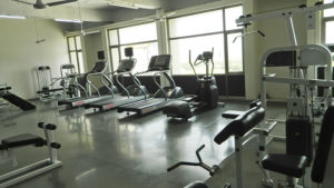 Empty fitness center with treadmills and exercise machines