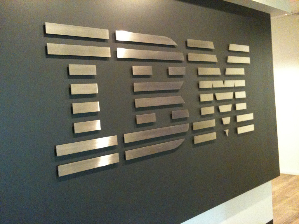 The IBM logo on a gray wall