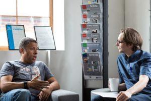 Two men in an informal meeting, talking